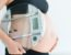 weight gain during pregnancy with pregnant woman holding scale
